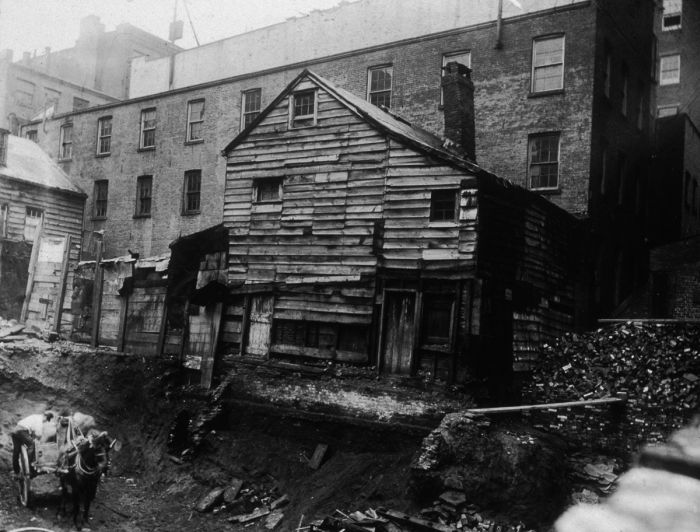 circa 1890: View of a back-lot house on Bleecker Street between Mercer and Greene Streets, adjacent to an excavation site, New York City. (Photo by Jacob A. Riis/Museum of the City of New York/Getty Images)