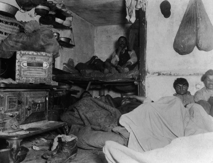 circa 1890: Lodgers in a crowded and squalid tenement, which rented for five cents a spot, Bayard Street, New York City. Twelve men and women slept in a room not thirteen feet either. It was photographed by flashlight. (Photo by Jacob A. Riis/Museum of the City of New York/Getty Images)